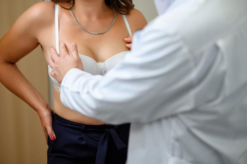 показания к операции по уменьшению груди
